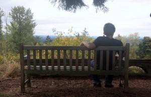 Boy sitting on bench.